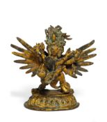 WINGED HERUKA WITH HIS CONSORT IN YAB-YUM. Tibet/Nepal. 19th/20th c. Copper bronze with fire