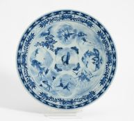 LARGE DISH WITH HOTEI, LANDSCAPE MEDALLIONS, BIRDS AND WATER ANIMALS. Japan. 19th c. Porcelain