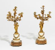 PAIR OF CANDELABRA STYLE LOUIS XV WITH CUPIDS MADE OF MARBLE AND BRONZE. Paris. End of the 19th
