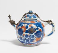 SMALL TEA POT. China. 18th c. Export porcelain painted in underglaze blue with iron red and gold