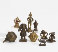 NINE SMALL FIGURES, MASK AND BOX. India. 18th-20th c. Bronze, partly with dark patina and residue of