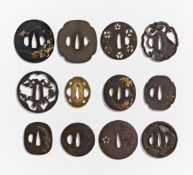 TWELVE TSUBA. Japan. 18th-19th c. and earlier. Two in bronze, ten from iron. Partly with inlay and