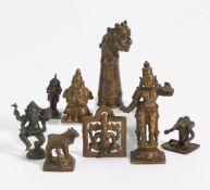 EIGHT SMALL FIGURES. India. 18th-20th c. Bronze with dark patina. a) Standing goddess. H.10.2cm.