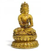 EXTRAORDINARY FIGURE OF BUDDHA AMITAYUS. Tibet. 17th/18th c. or earlier. Light bronze with residue
