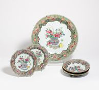 A LARGE AND FOUR SMALL PLATES WITH A FLOWER BASKET WITH PEONIES. China. Qing Dynasty. 18th c. Export