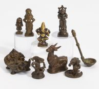 EIGHT FIGURES OF GODS AND A SMALL SPOON. India. 18th-20th c. Bronze with dark patina and residue