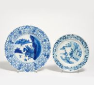 TWO UNDERGLAZE BLUE DISHES WITH LOTOS RIM. China. Porcelain painted underglaze blue. a) Two