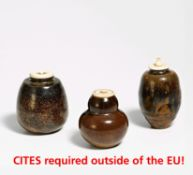 THREE CADDIES FOR POWERED TEA (CHAIRE). Japan. 18th/19th c. Fine light grey stoneware. a) Bulbous