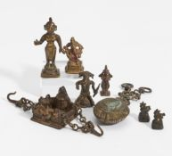 EIGHT FIGURES OF GODS AND OTHERS. India. 18th-20th c. Bronze with dark patina and residue of