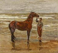 Junge mit Pferd am Strand