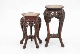 A lot with (2) Chinese plant stands, 20th century.