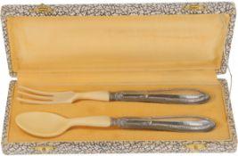 (2) Piece silver cutlery set.