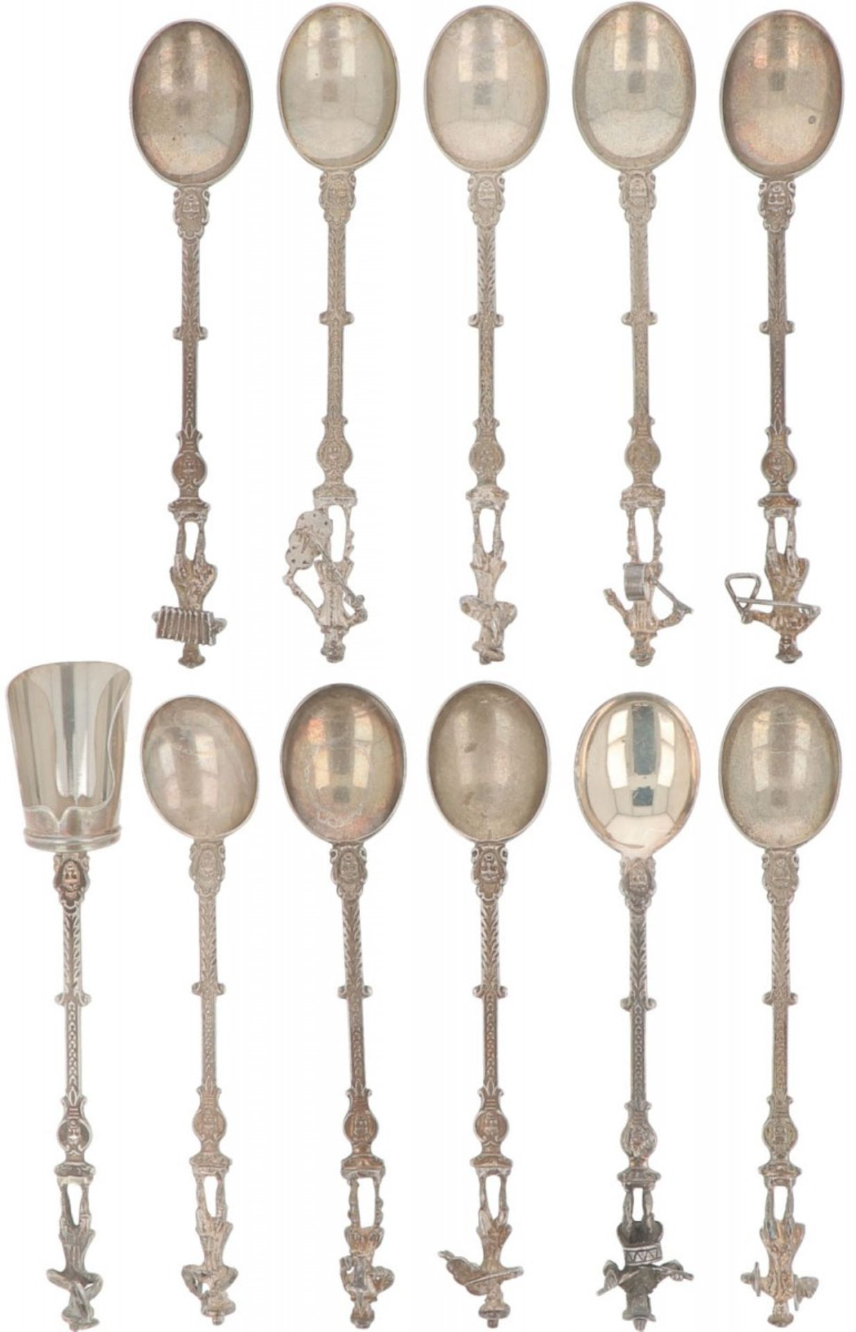 (11) piece set of teaspoons & sugar scoop silver.