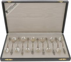(12) piece set of silver teaspoons.