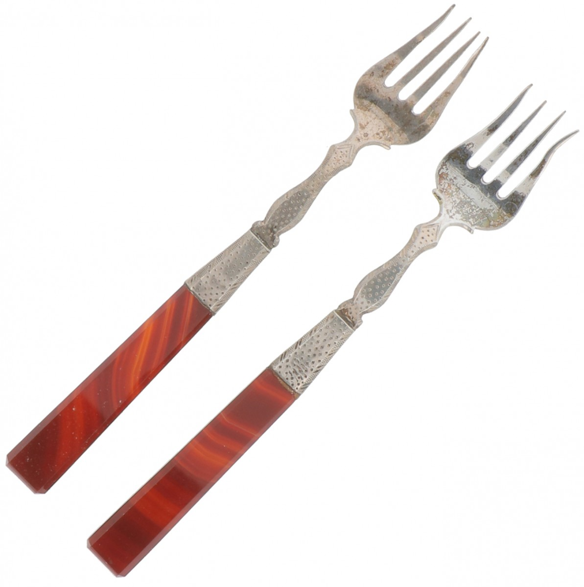 (2) piece set of silver meat forks.