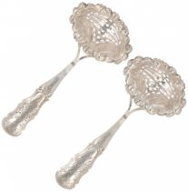 (2) piece set scattering spoons silver.
