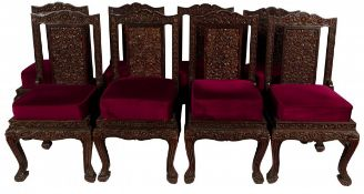 A set of (8) Balinese carved dining chairs, Indonesia, 20th century.