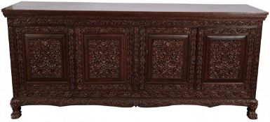 A hardwood sideboard with Balinese carvings, Indonesia, 2nd half of the 20th century.