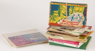 """A lot comprised of various books and comic albums, a.w. the """"Avonturen van Tom POes"""", 20th century."""