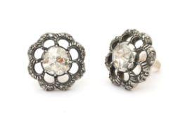 A pair of 14 karat gold and silver rose cut diamond ear studs