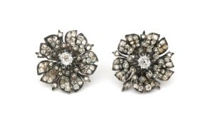 A pair of 14 karat gold and silver diamond earrings