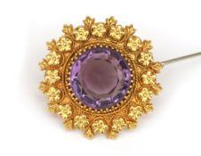 A 14 karat gold amethyst brooch