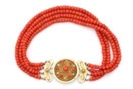 A precious coral four strand neckace to a 14 carat gold clasp