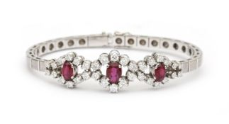 An 18 karat white gold ruby and diamond bracelet