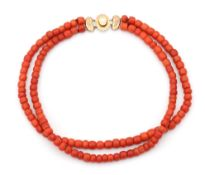 A precious coral two strand necklace on a 14 karat gold clasp