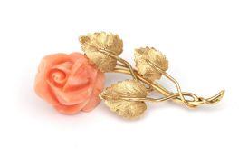 An 18 karat gold flower brooch with angelskin coral