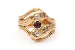 A 14 karat gold gold diamond and ruby snake ring
