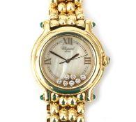 An 18 karat gold Chopard Happy Sport lady's wristwatch, 1995
