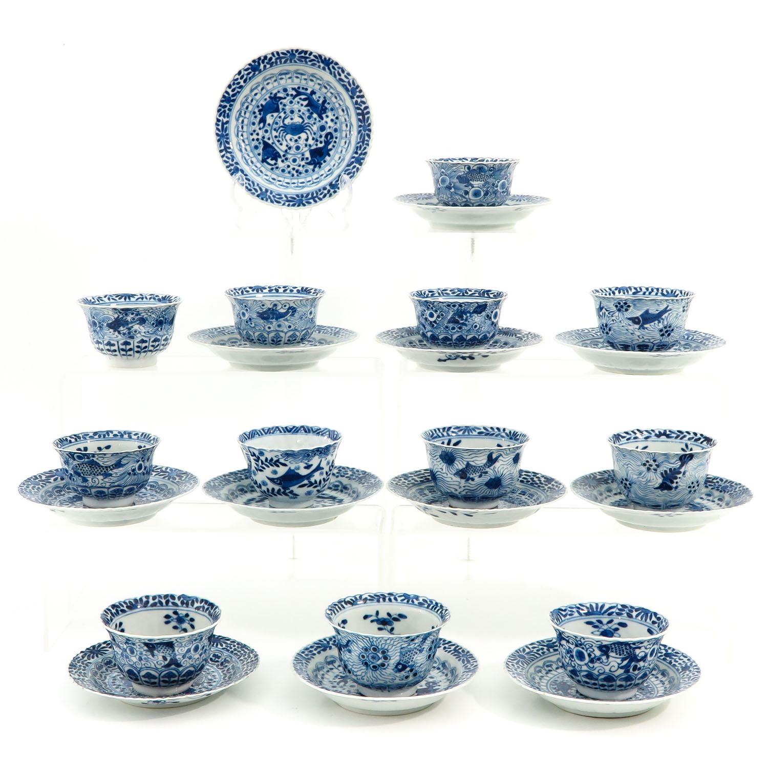 A Series of 12 Cups and Saucers