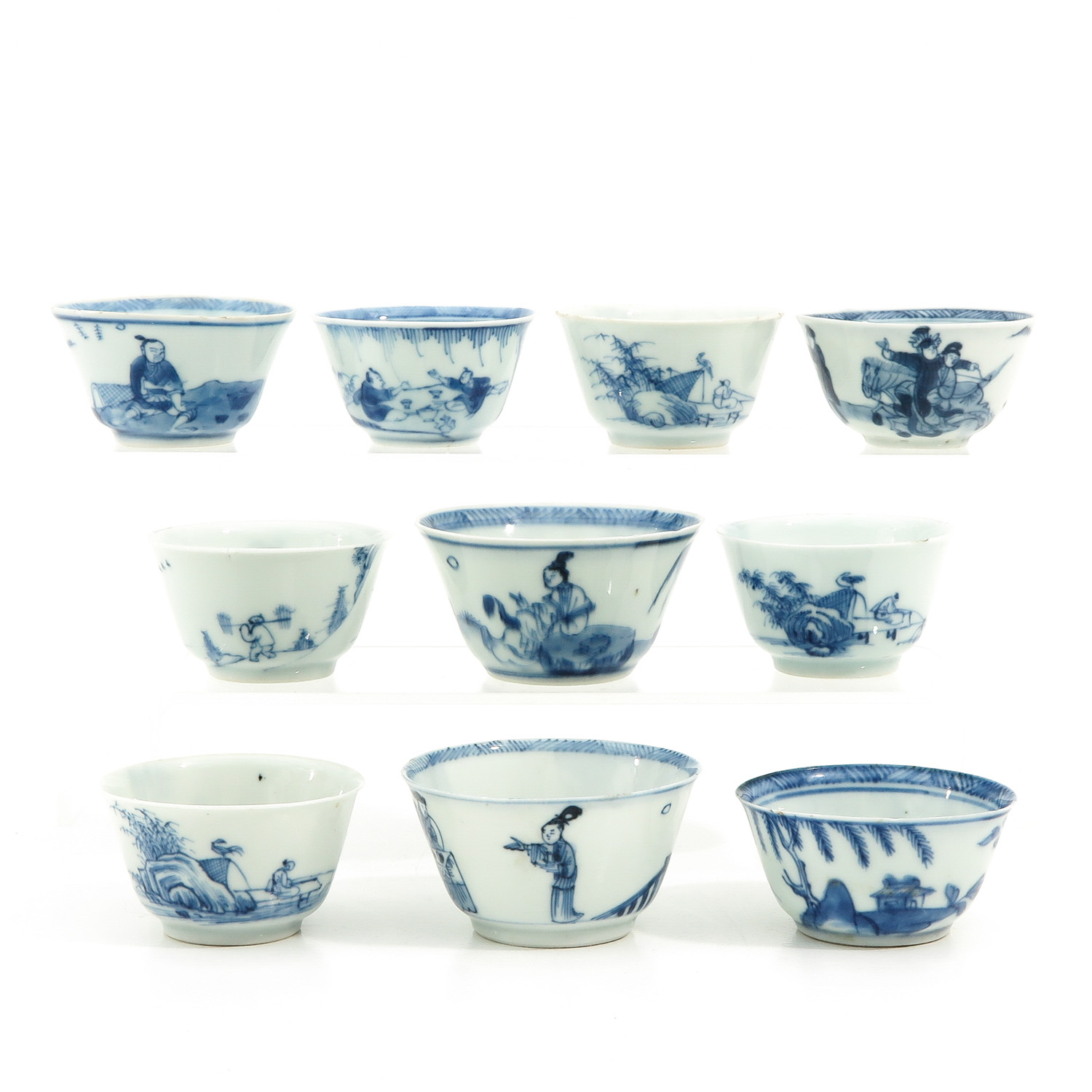 A Collection of 10 Blue and White Cups
