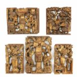 A Collection of Carved Wood Plaques