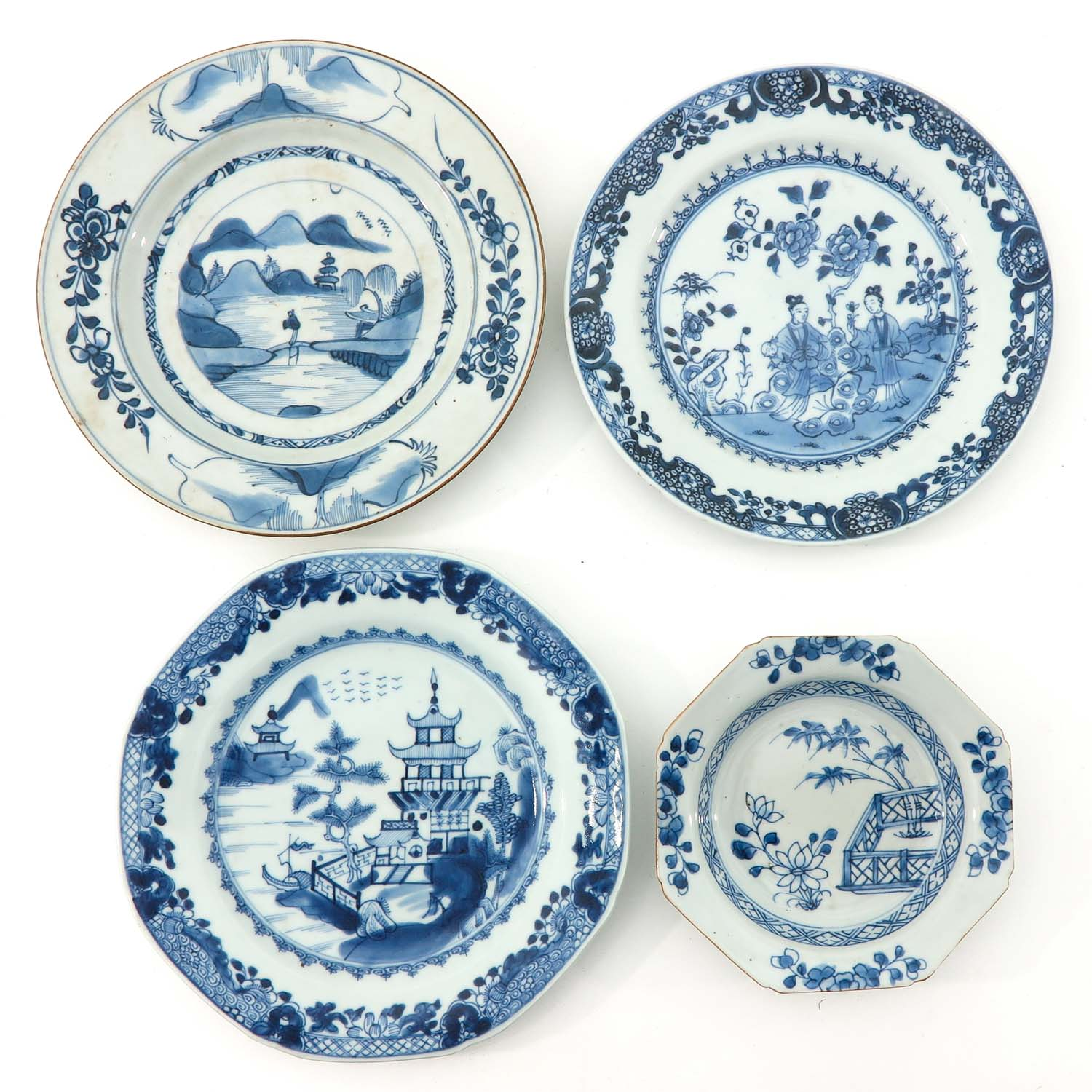 A Collection of 4 Blue and White Plates