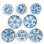 A Collection of 8 Blue and White Saucers