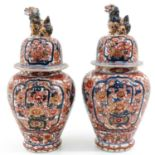 A Pair of Imari Vases and Covers