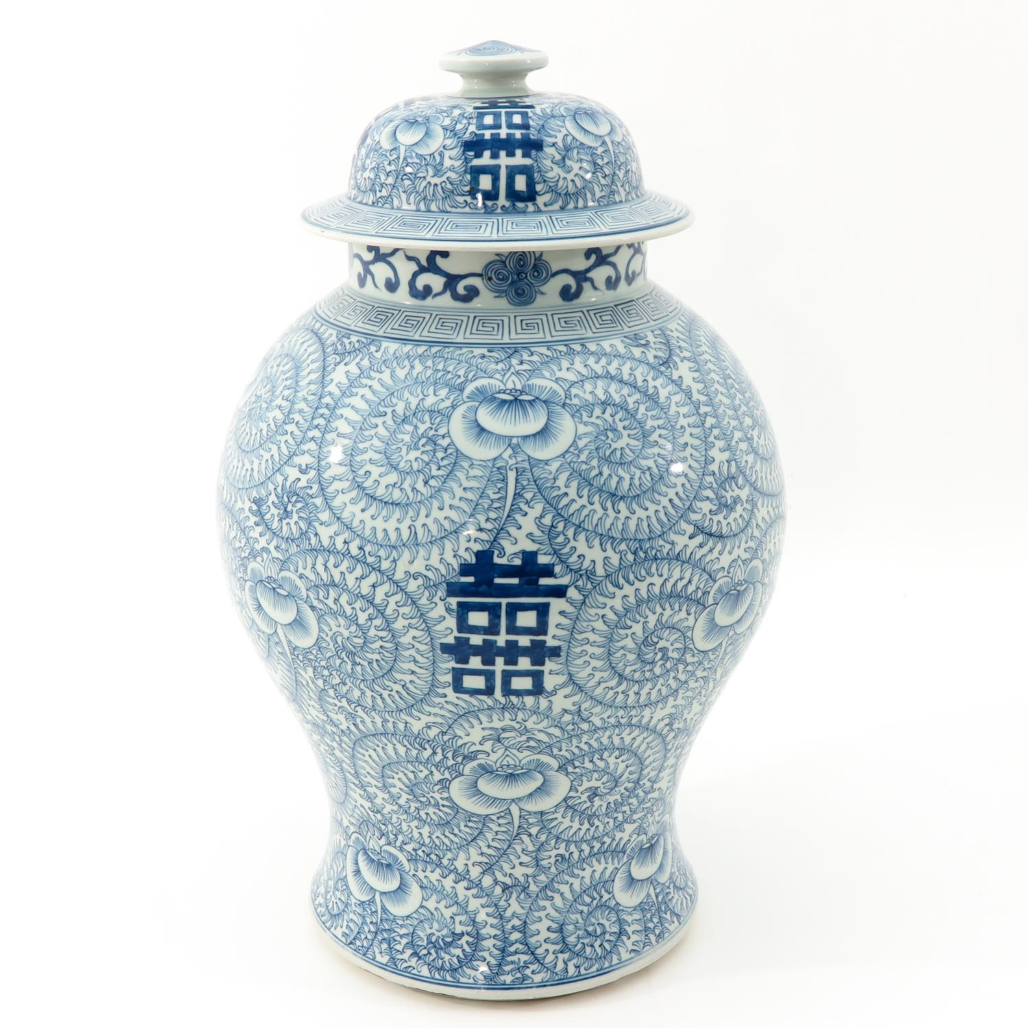 A Blue and White Vase with Cover