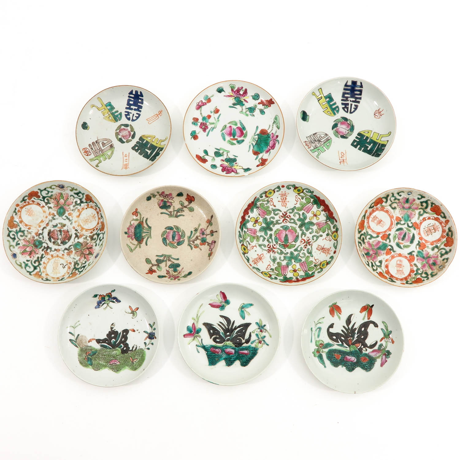A Collection of 10 Polychrome Decor Plates