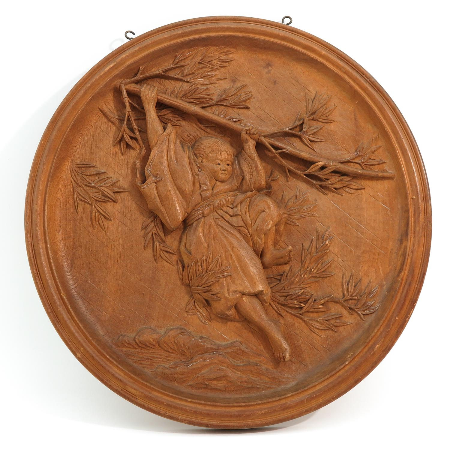 A Round Carved Wood Panel