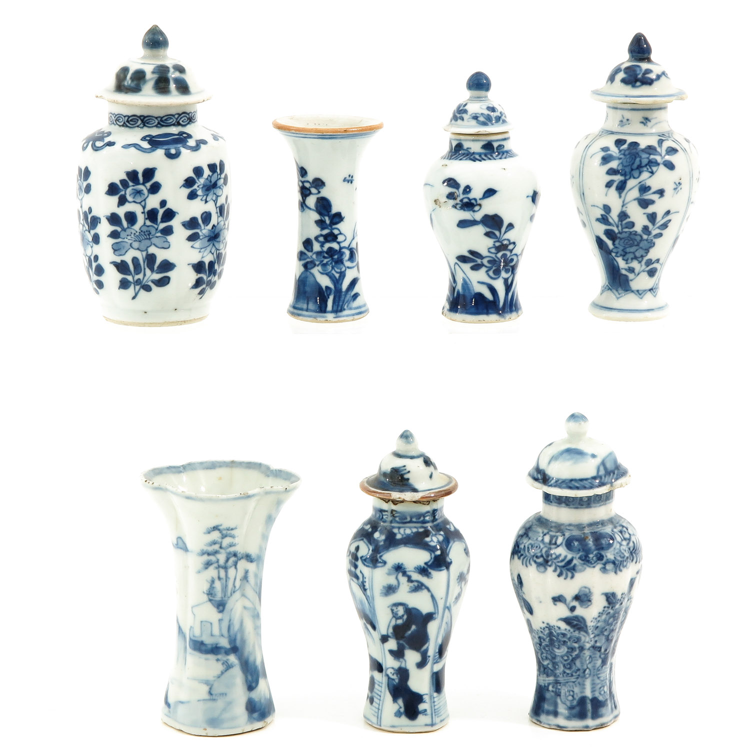 A Collection of 7 Miniature Vases