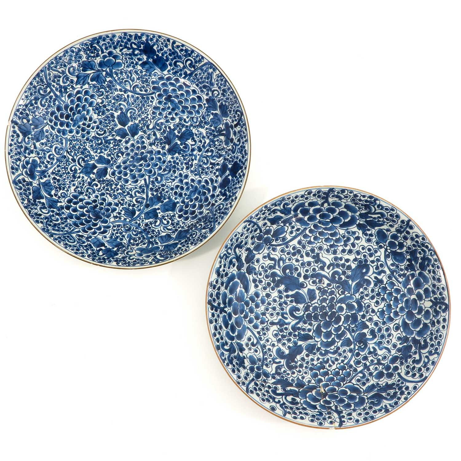 A Pair of Blue and White Chargers