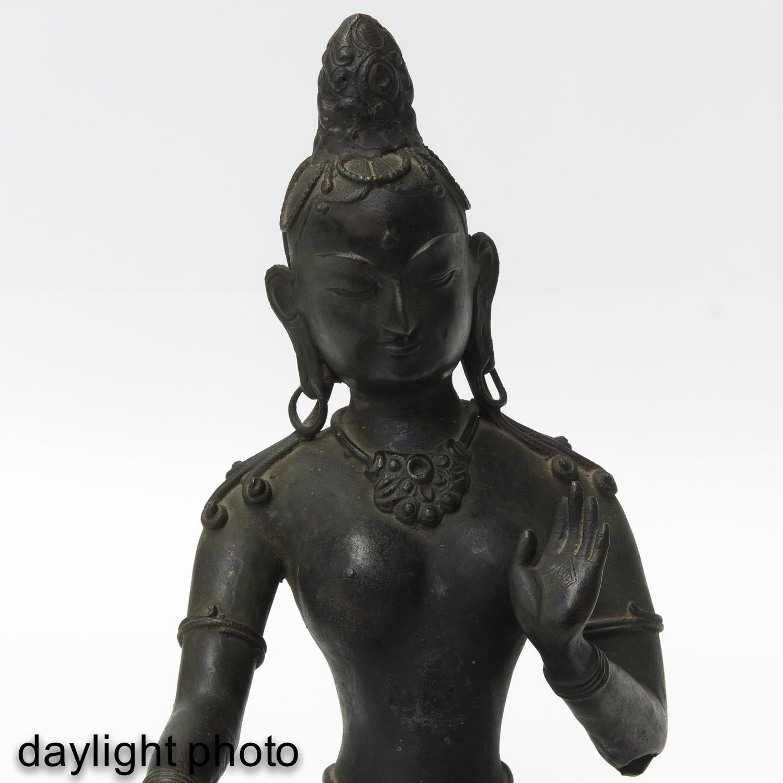 A Bronze Buddha Sculpture - Image 9 of 9