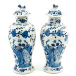 A Pair of Blue and White Covered Vases