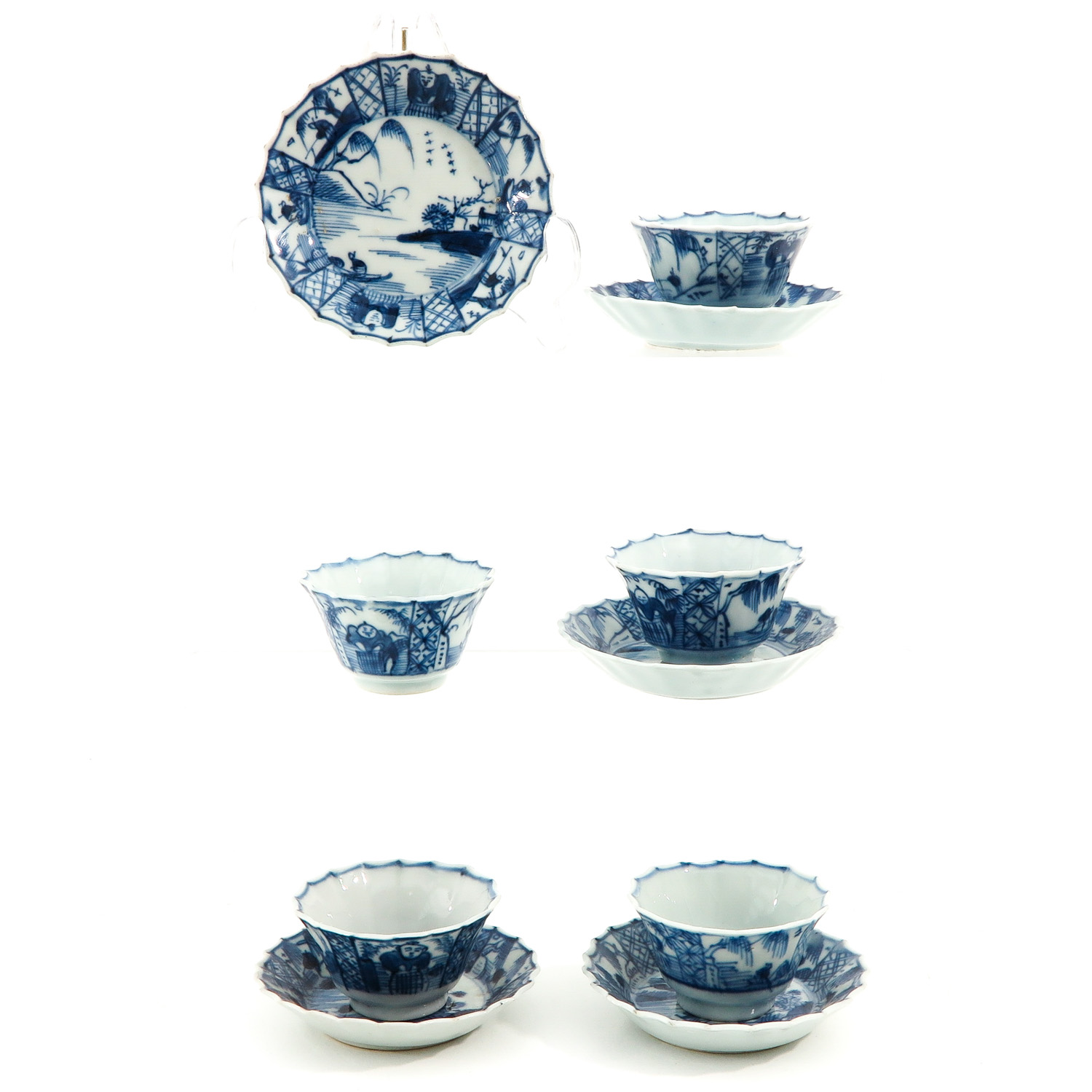 A Collection of 5 Cups and Saucers