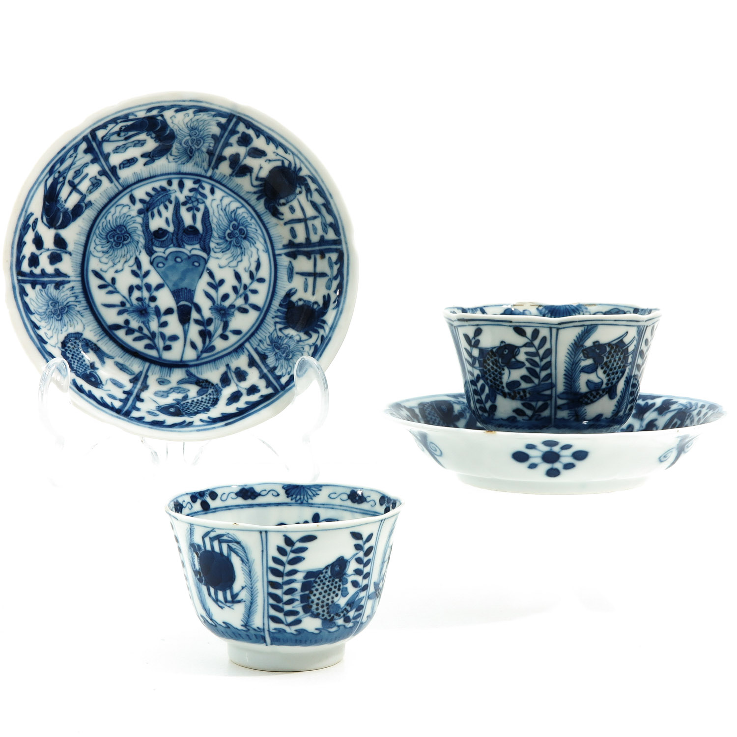 A Pair of Blue and White Cups and Saucers