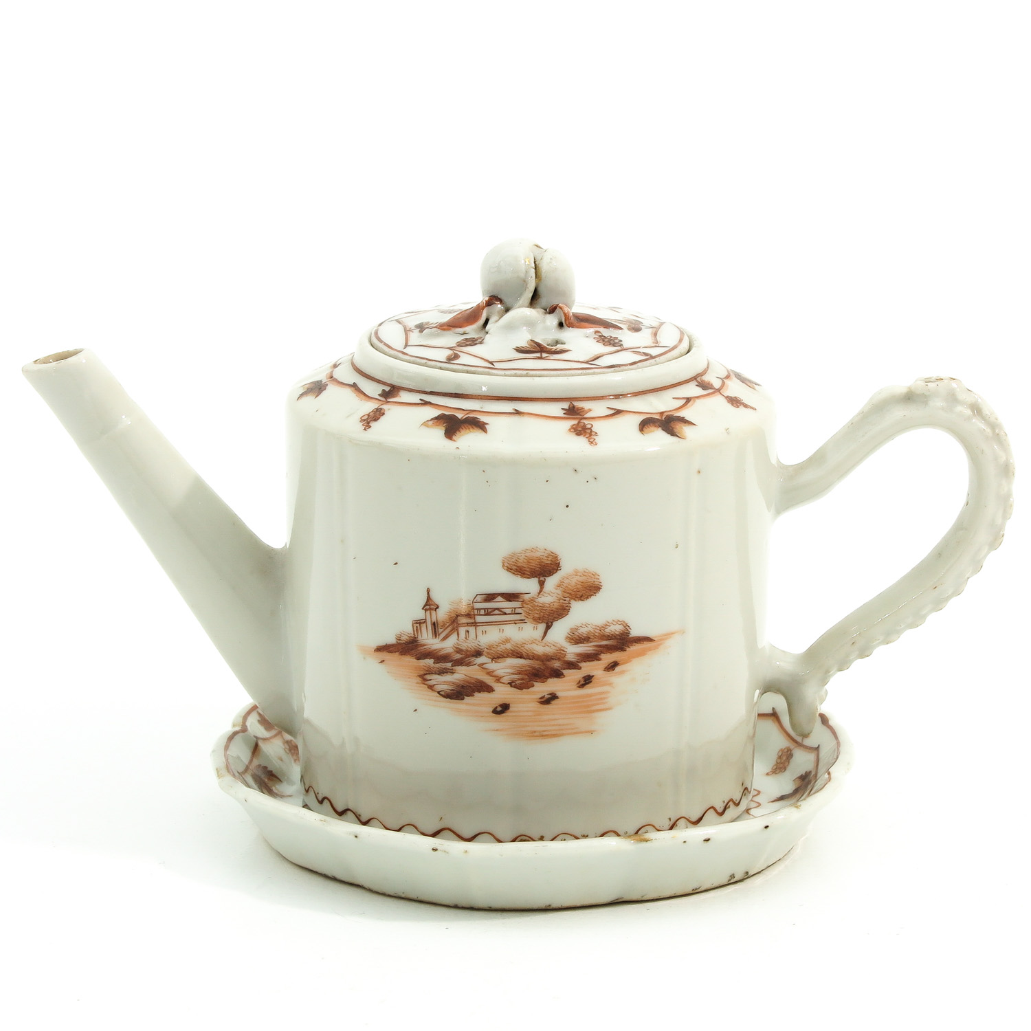 A Teapot and Small Dish