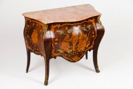 A small Louis XV style commode