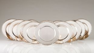 Twelve under platesPortuguese silver Plain centre of engraved lip with band and ribbon decoratio